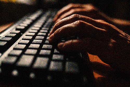 hands of a person on a keyboard