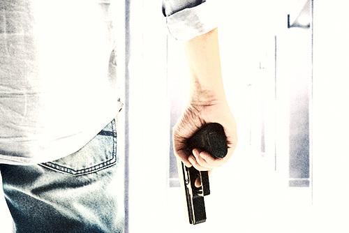 man brandishing his firearm