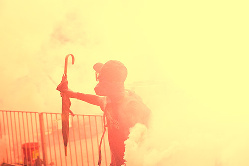 masked person throwing tear gas as an example of a crime under Penal Code 22810 PC
