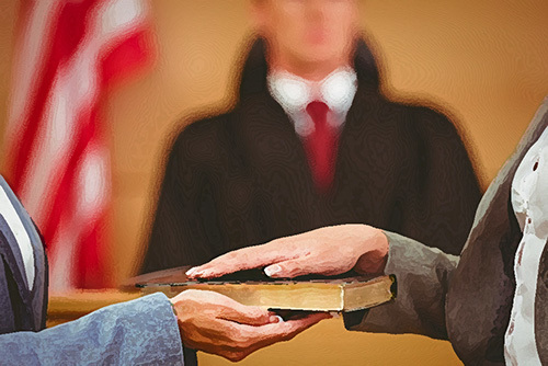 person swearing into an oath