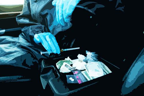police find drugs under arm wrest of car