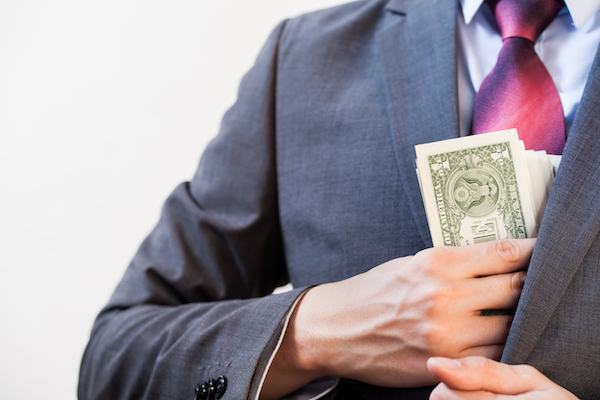Employee pocketing cash for himself his boss gave him to buy office eqiupment with.