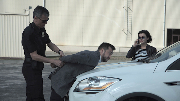 Man being arrested after contacting his ex-girlfriend in violation of a domestic violence protection order.