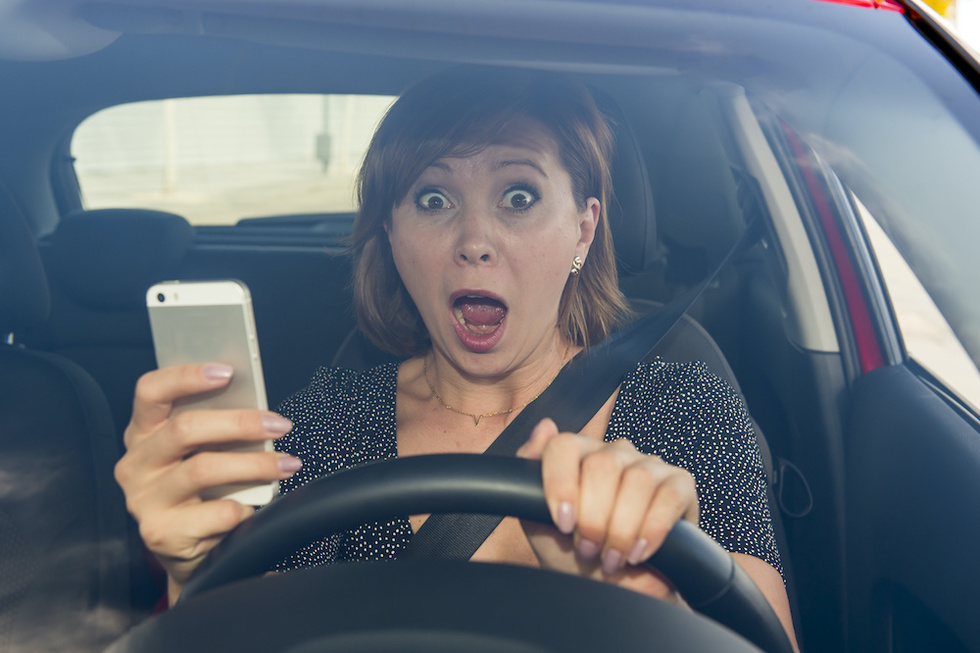 Girl about to crash distracted driving cellphone