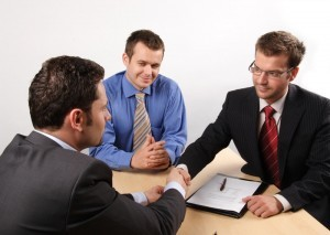 Businessmen agreeing w mediator canstockphoto1672166 300x213