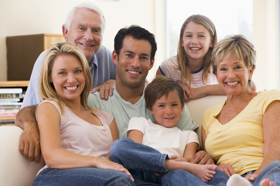 Extended family in living room smiling rtjd4trsi