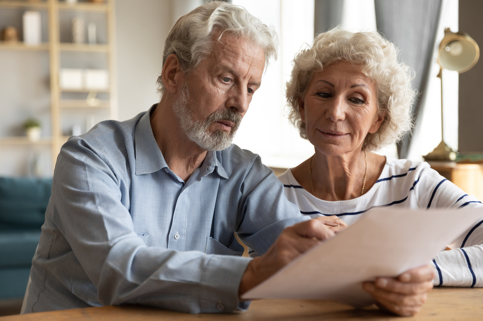 older 20couple 20with 20documents