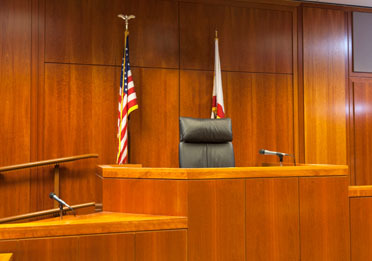 Istock courtroom witness stand and bench 372x261