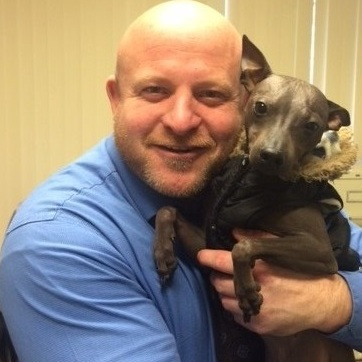 Fresno Criminal Defense Attorney with a four-legged friend