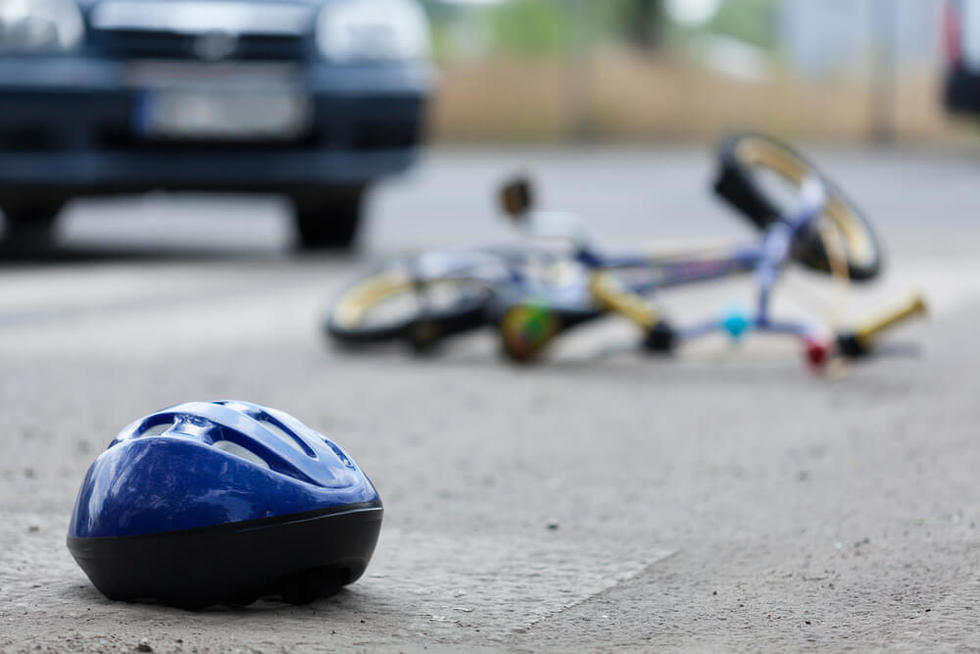 Bicycle rider struck by a car