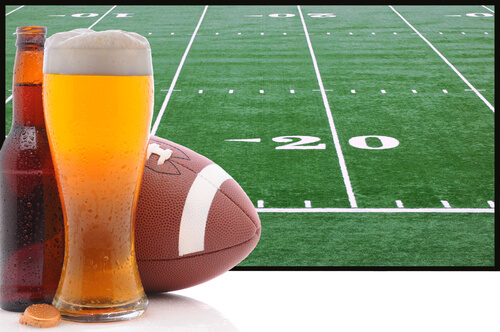 Alcohol and football next to Super Bowl field