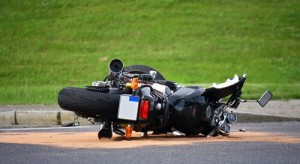 Motorcycle on it's side after collision