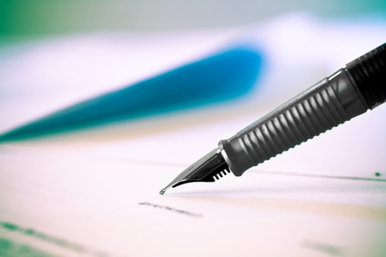 A pen poised to sign a legal document