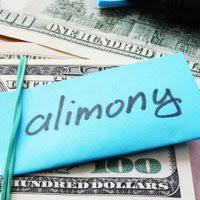 Alimony written on note on top of stack of money