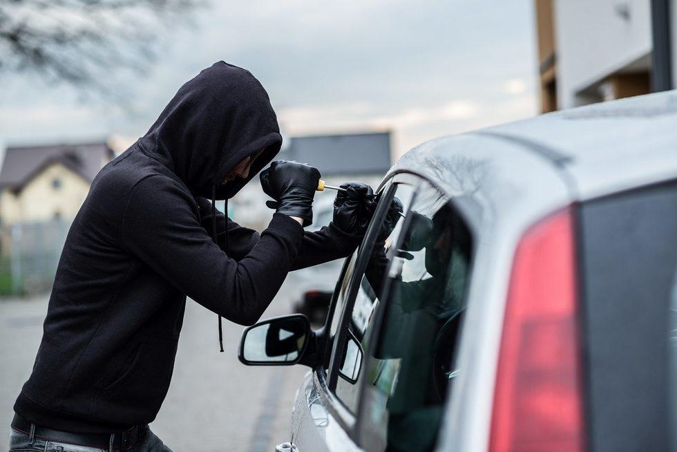 Bigstock car thief trying to break into 129418745