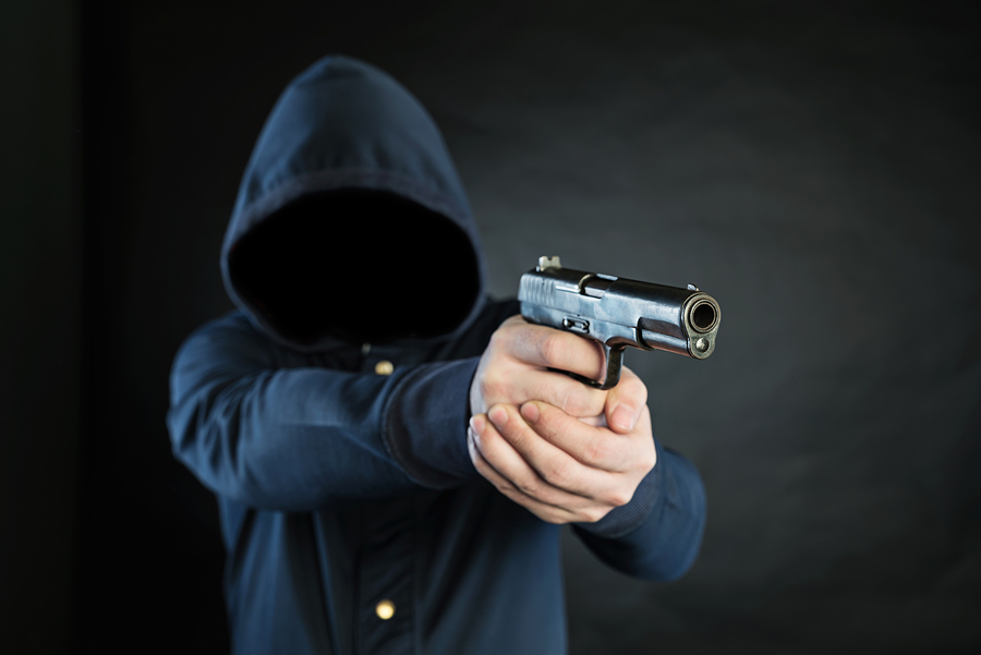 Bigstock armed person in a hoodie is po 90195365
