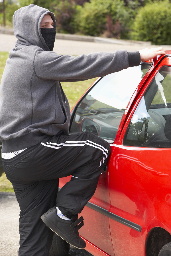 Bigstock young man breaking into car 13901576
