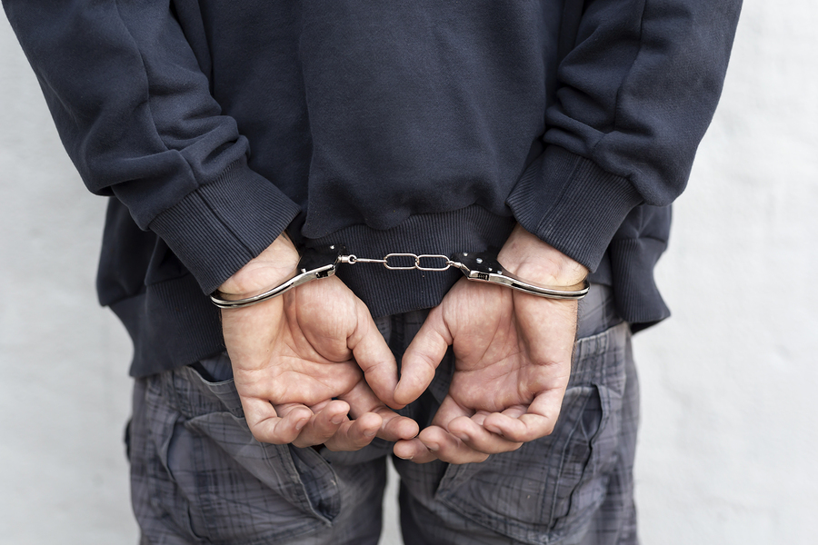 Bigstock criminal under arrest confined 267131188
