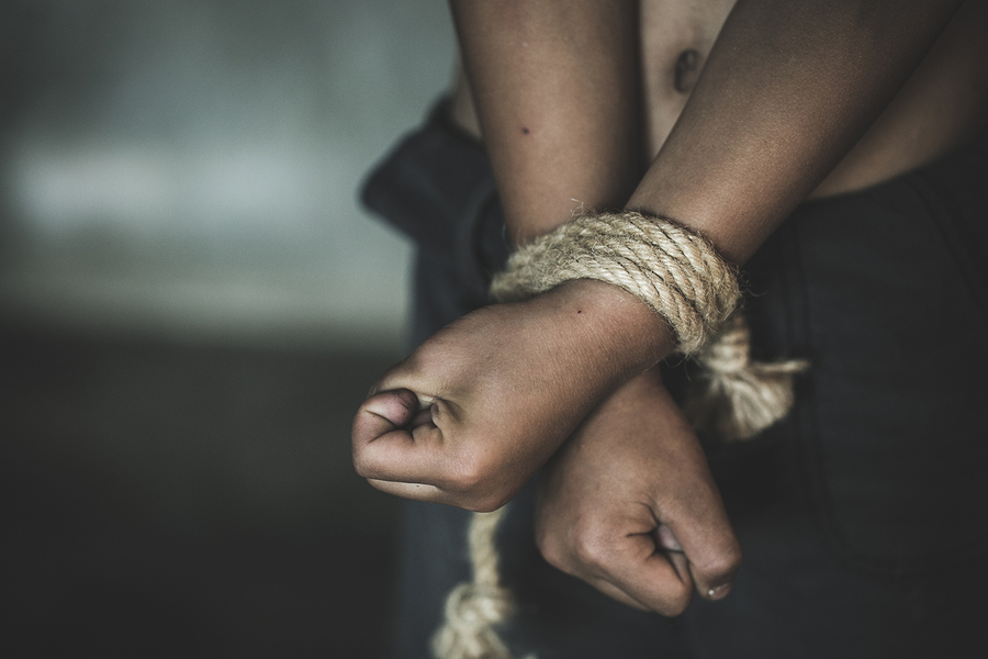 Bigstock hands tied up with rope of a m 269021617