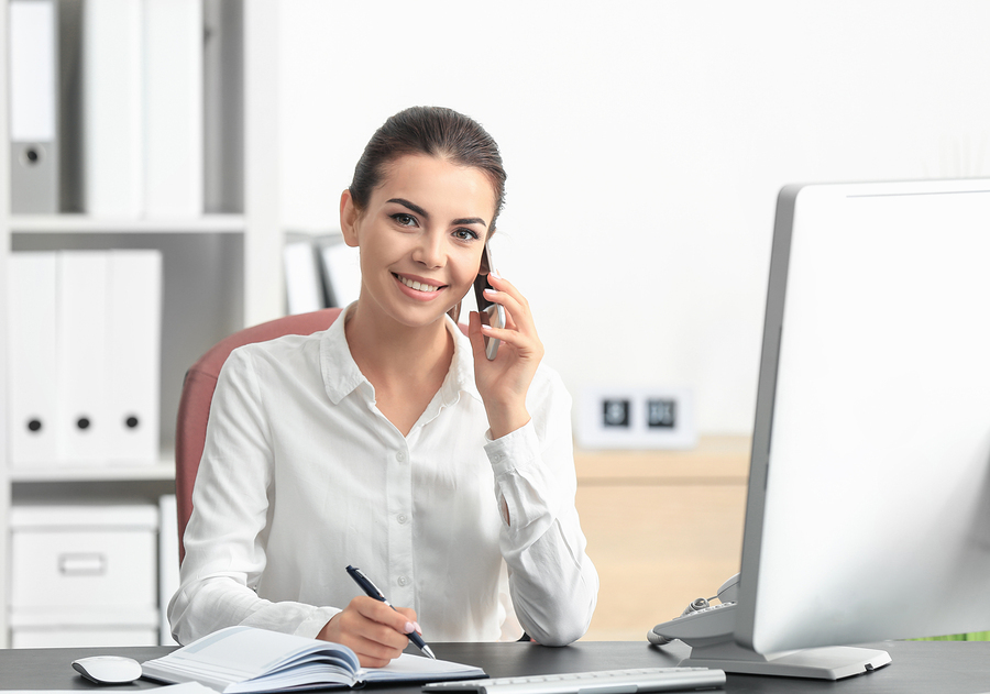 Bigstock young female receptionist talk 205987456
