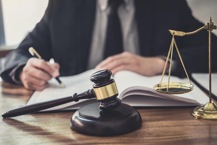 Bigstock male lawyer or judge working w 290555113