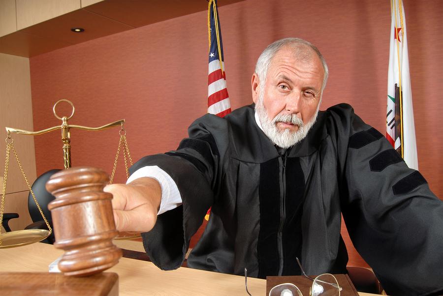 Bigstock judge using his gavel 3021360