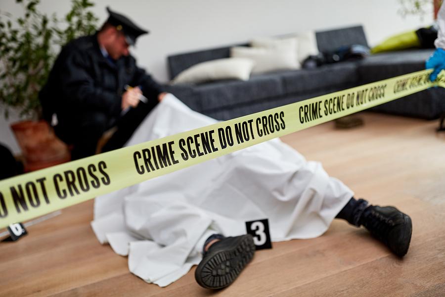 Bigstock policeman next to dead body in 339177499