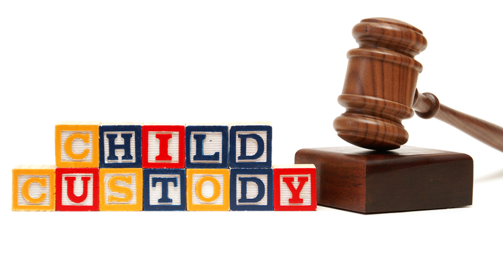 blocks spelling out child custody with gavel