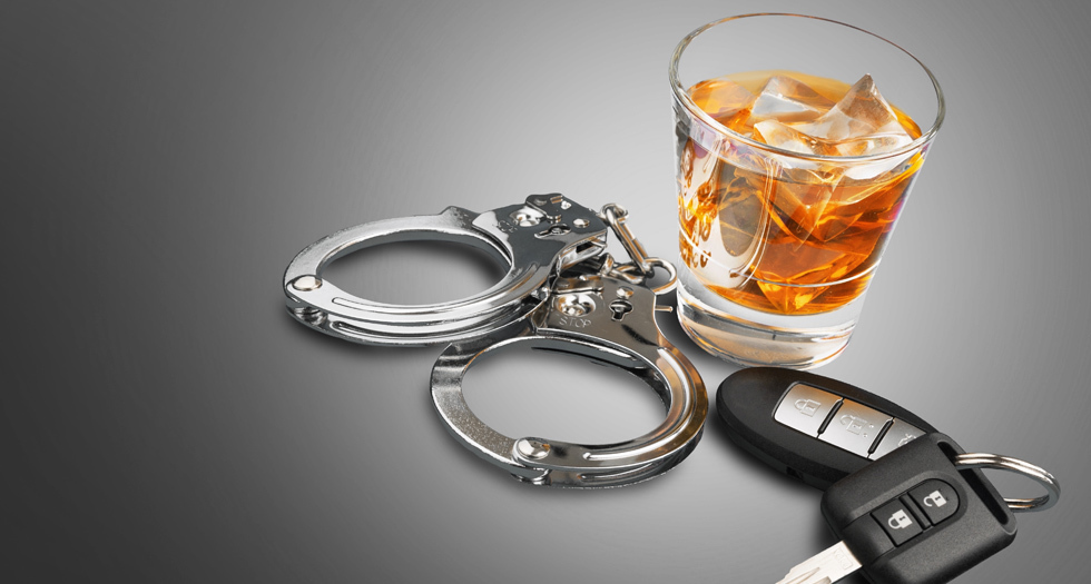 car keys hand cuffs empty glass