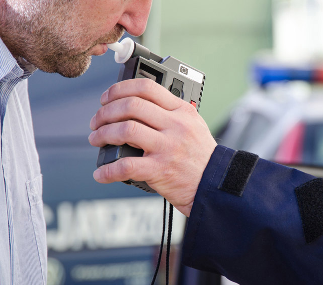 man taking breath test