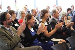 People applauding at a Pro Bono event.