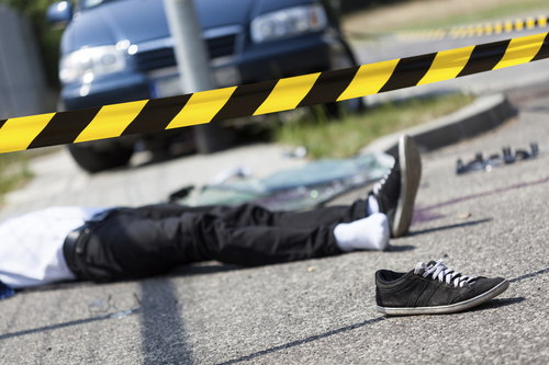 Pedestrian laying on the ground after being hit