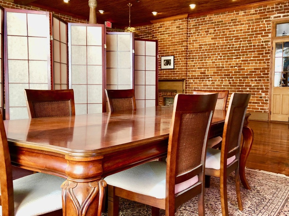 Office conference room meeting table and chairs for New Orleans Legal LLC and Attorney Peter J. Diiorio