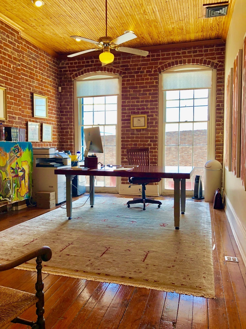 Office room with meeting table desk and chair in windows for New Orleans Legal LLC and Attorney Peter J. Diiorio