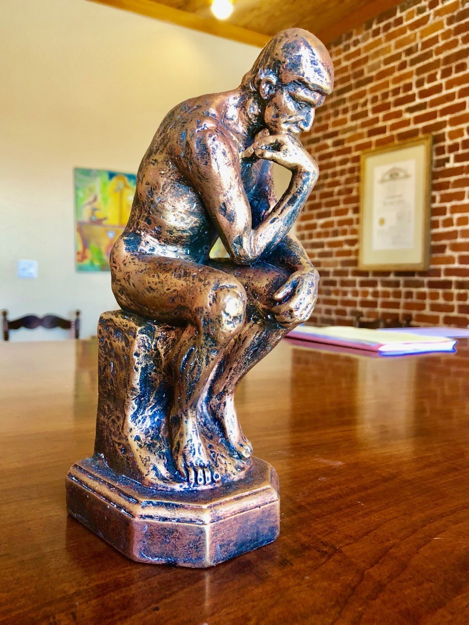 Rodin The Thinker sculpture on desk at New Orleans Legal, LLC and Attorney Peter J. Diiorio