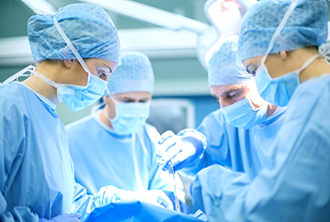 Surgeons in surgery