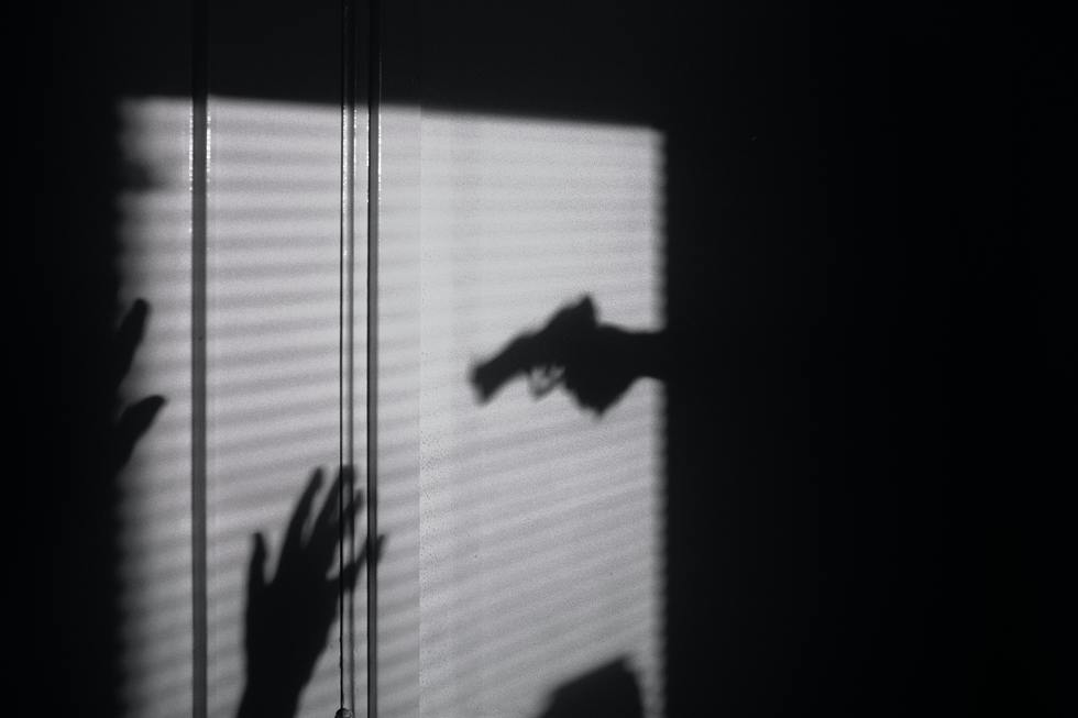 shadow of person pointing gun
