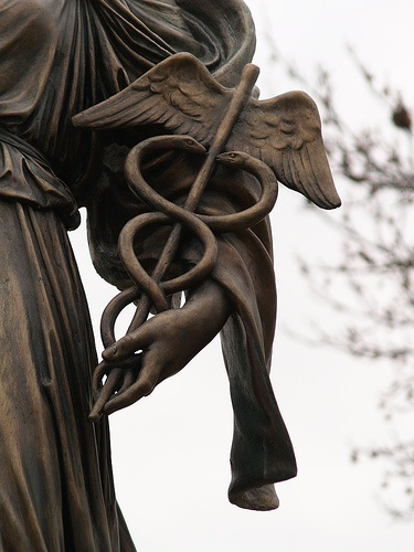 Detail of Bronze Sculpture Holding Medical Symbol, Caduceus