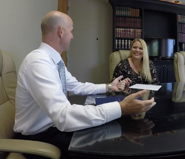 personal injury attorney talking to client about contingency fee