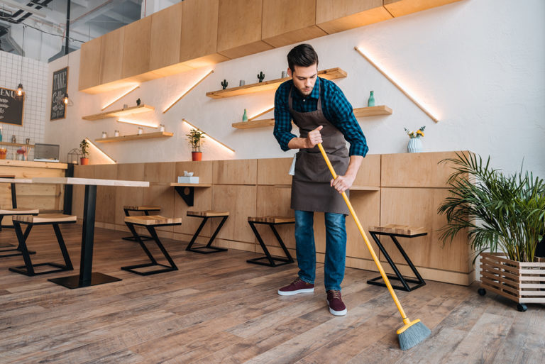 Bigstock worker cleaning floor with swe 199785664 768x513