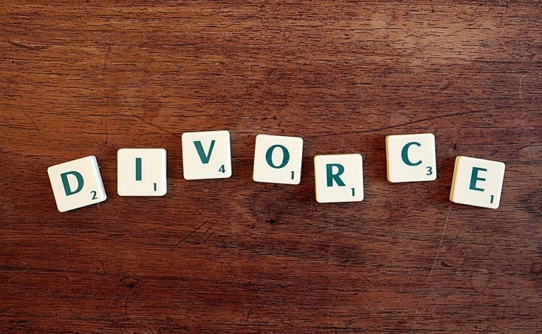 Scrabble tiles laid out on a table to spell divorce.