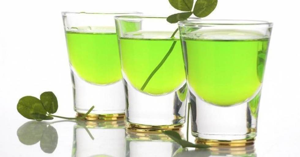 Festive green shots of alcohol with clovers for St. Patrick's Day