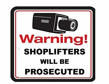Sign that says Warning! Shoplifters will be prosecuted
