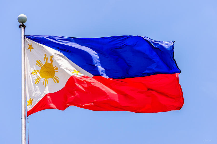 Flying national flag of the philippines over rizal park manila colin utz