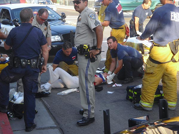 Image of pedestrial being attended to by medical personnel