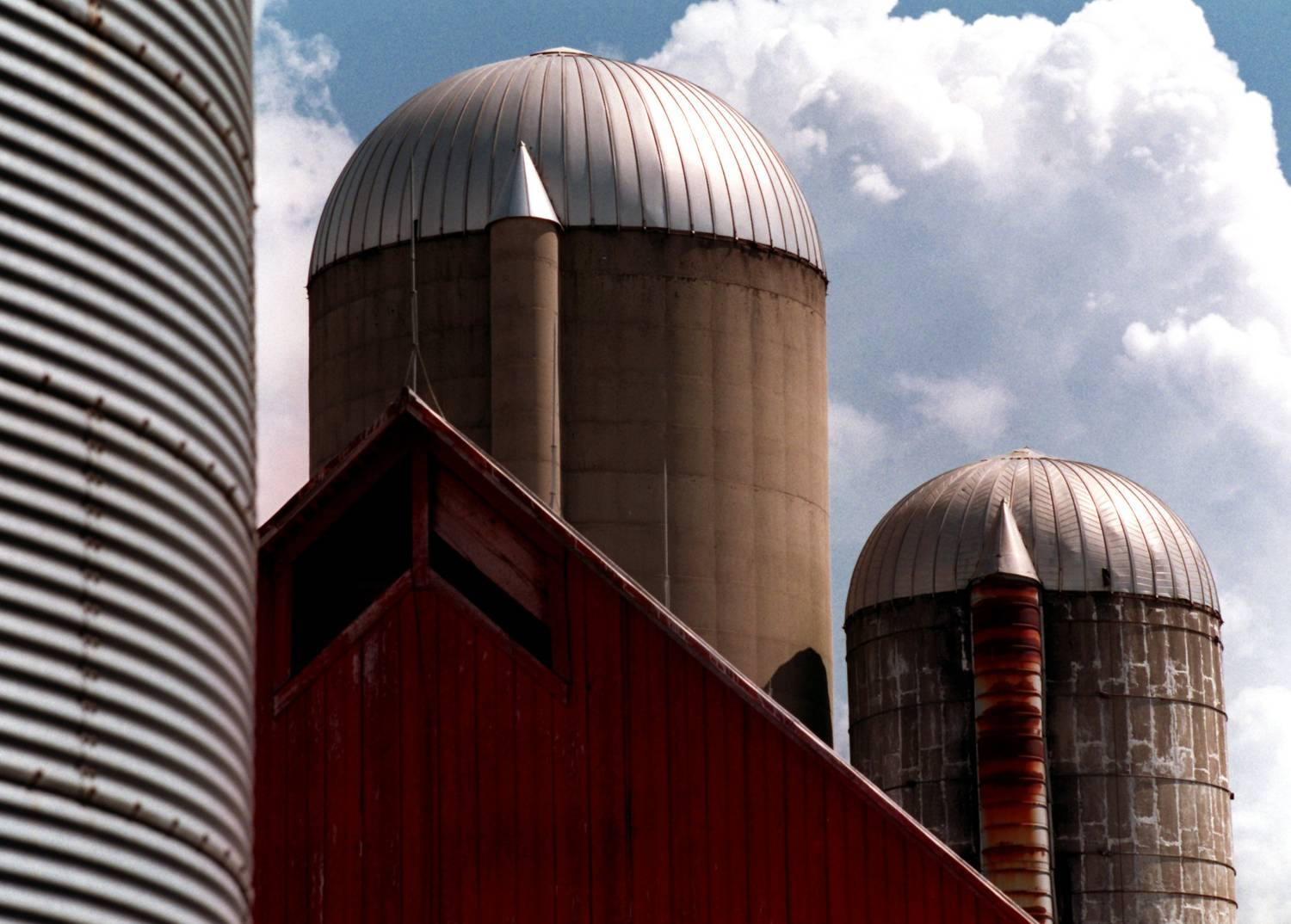 Grain silos against clouds.