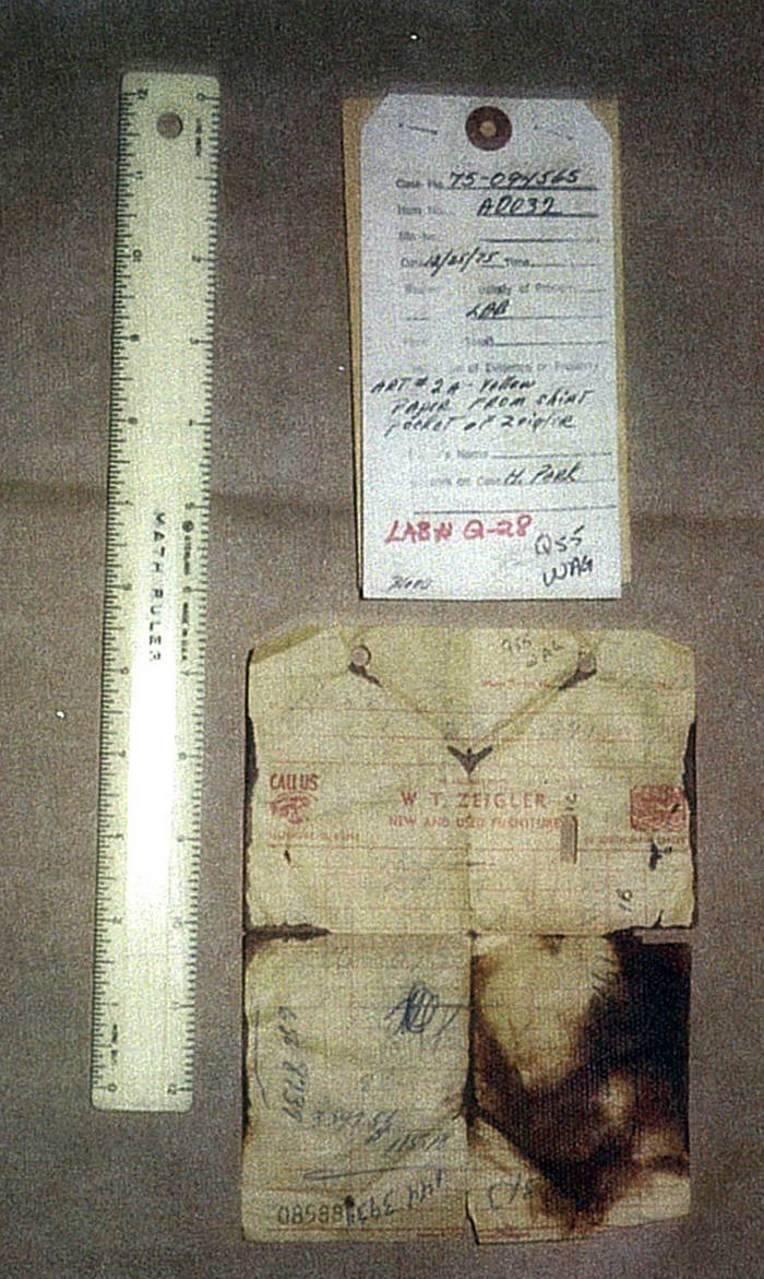 Evidence photo of a sales tag and a receipt, with a ruler alongside for comparison.