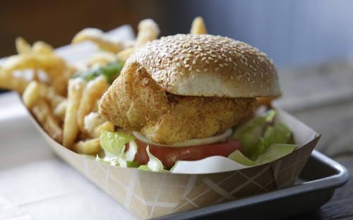 Fried grouper sandwich. [JAMES BORCHUCK  | Times]