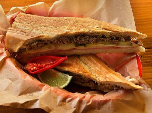 A Cuban sandwich and an aqua fresca.  [SCOTT KEELER  |  Times]