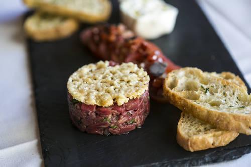 Branzino with lemon, garlic, herbs, escarole and white beans [EVE EDELHEIT  |  Times]